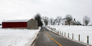 The Jacob Spears house is on the right of the Clay-Kiser road in this picture. On the left is the storage barn for whiskey.