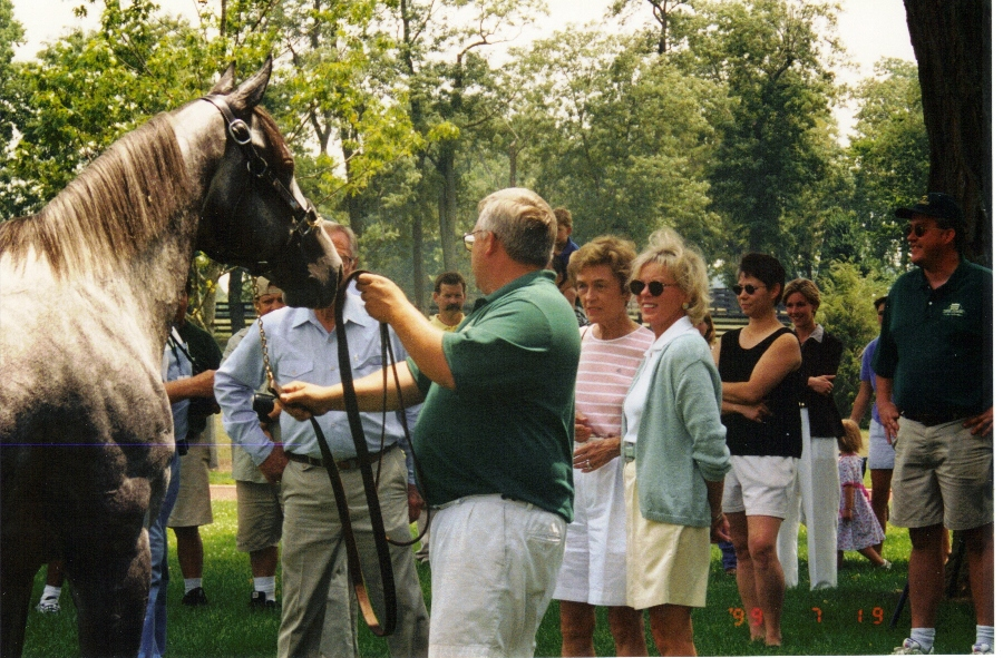 Left to right, Silver Charm (obscuring Bob Lewis), Tom Wade, Beverly Lewis, Blythe Clay -- with many Three Chimneys friends in the background.