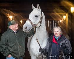 Silver Charm arrives at Old Friends, welcomed by Michael Blown and Three Chimneys' current stallion manager Sandy Hatfield.