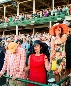 "A family at Churchill Downs reacts to the singing of ""My Old Kentucky Home."" (Copyright photo by Bobby Shiflet.)"