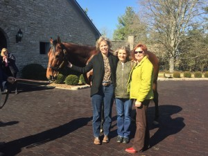College friends visiting equine royalty.
